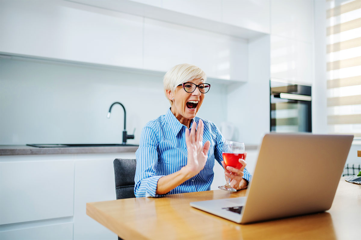 Middle-Aged Woman Buying Wine Online